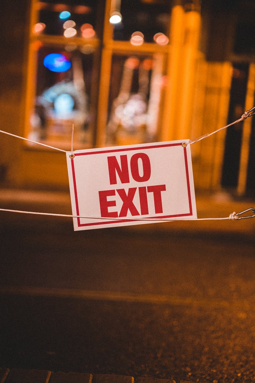 sign hanging on street prohibiting exit